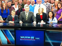 Caroline Gable has recently exited WUTR. She's next to Joe Parker behind the anchor desk in this shot from September 2011. (Click for full-size)