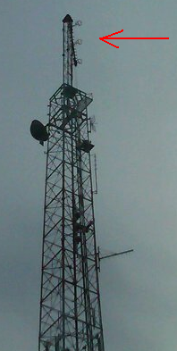 Look by the red arrow and you'll see the tip of WKTV's tower, dangling precariously. Photo by Grant deBruin.