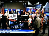 Staffers gather around WSTM anchor Jackie Robinson during her final broadcast in September.