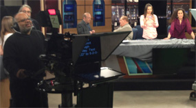 WUTR/WFXV production crew members record PSAs to raise money for Herkimer shooting victims.  GM Stephen Merren is at the anchor desk, chatting with WIBX's Bill Keeler. [Click for full-size version]